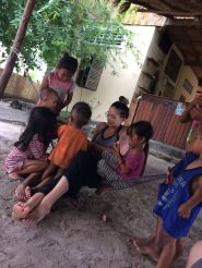 At Seapony spending time with the village children and being taught Khmer
